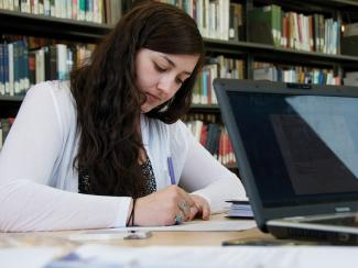 Medaille College Student in Library